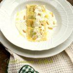Tortelli di ricotta e spinaci su fonduta di parmigiano e pinoli